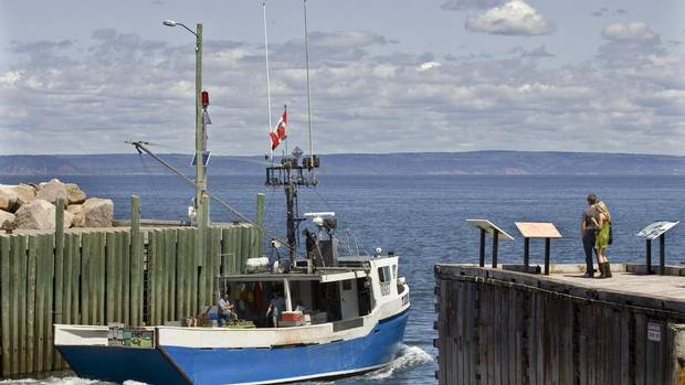 A fishing boat heads out on the Bay of Fundy from Hall's Harbour, N.S. The possibility of creating clean energy from tidal currents – in shallow water along the coast or in rivers – has captured the interest and investment of Canadian, American and European companies. They have made great strides in the small-turbine field that could potentially tap the power of tidal currents. (Andrew Vaughan/The Canadian Press)