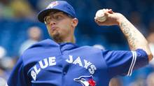 Toronto Blue Jays starting pitcher Brett Cecil throws against the Detroit Tigers in the first inning of their American League MLB baseball game in Toronto July 29, 2012. (Reuters)