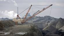 A dragline works in coal pits in front of a SaskPower station near Estevan, Sask., on March 25, 2008. (Troy Fleece/The Canadian Press)