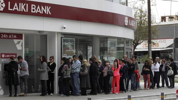 "People queue up at an ATM outside a branch of Laiki Bank in Nicosia March 21, 2013. Cypriot politicians searched desperately on Thursday for a ""Plan B"" to find billions of euros to clinch a European Union bailout and avert a financial meltdown after parliament rejected a bank deposit levy. (ANDREAS MANOLIS/REUTERS)"