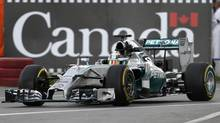 Mercedes's Lewis Hamilton drives during the first practice of the Canadian F1 Grand Prix in Circuit Gilles Villeneuve in Montreal. (MATHIEU BELANGER/REUTERS)
