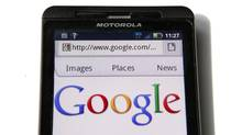 A Google homepage is displayed on a Motorola Droid phone in Washington in this August 15, 2011 file photograph. (KEVIN LAMARQUE/REUTERS)