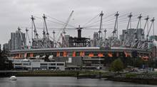 B.C. Place stadium is pictured from the east end of False Creek as work continues on a new retractable fabric roof in Vancouver, B.C., on Friday October 8, 2010. The stadium hosted the opening and closing ceremonies during the Vancouver Olympics. (DARRYL DYCK)