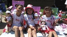 Beaming with Canadian pride, Three cousins Sarah, Emily and Stephanie celebrated Canada Day with their Maplelea Girls at the parade in Cambridge, Ont. Photo supplied by Maplelea Girls