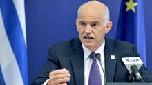 George Papandreou is president of the Socialist International and a former prime minister of Greece. (ERIC VIDAL/REUTERS)