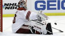 Phoenix Coyotes goalie Ilya Bryzgalov (30) of Russia throws back the puck after giving up the third goal during the first period in Game 2 of a first-round NHL Stanley Cup playoffs hockey series against the Detroit