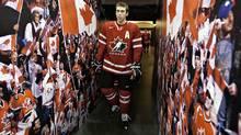 Team Canada's assistant captain Brandon Gormley walks to the ice at the Canadian national junior hockey team practice in Edmonton, Sunday Dec. 25, 2011. (JASON FRANSON/The Canadian Press)