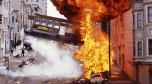 "An explosion and a flying cable car in downtown San Francisco are shown in a scene from the 1996 action drama ""The Rock."" (REUTERS)"