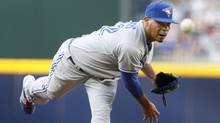 Toronto Blue Jays pitcher Esmil Rogers delives a pitch against the Atlanta Braves during the first inning of their MLB inter-league baseball game in Atlanta, Georgia May 29, 2013. (Reuters)