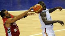Canadia's Denham Brown (R) is blocked by Lebanese Fadi El Katib during the preliminary round match of the Group D between Canada and Lebanon at the FIBA World Basketball Championships in Izmir, on August 28, 2010. Getty Images/ FRANCK FIFE (FRANCK FIFE)