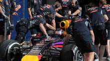 Red Bull mechanics push Sebastian Vettel's car during the final day of pre-season testing at the Bahrain International Circuit in Sakhir, Bahrain, Sunday, March 2, 2014. (Hasan Jamali/AP Photo)