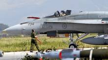 A Canadian Forces CF-18 Hornet fighter jet taxis at the Birgi NATO Airbase in Trapani, Sicily, March 24, 2011 (TONY GENTILE/Tony Gentile/Reuters)