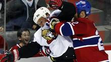 Montreal Canadiens' Paul Mara gets called for holding Ottawa Senators' Alexei Kovalev during the third period in Montreal on Saturday. (CHRISTINNE MUSCHI)