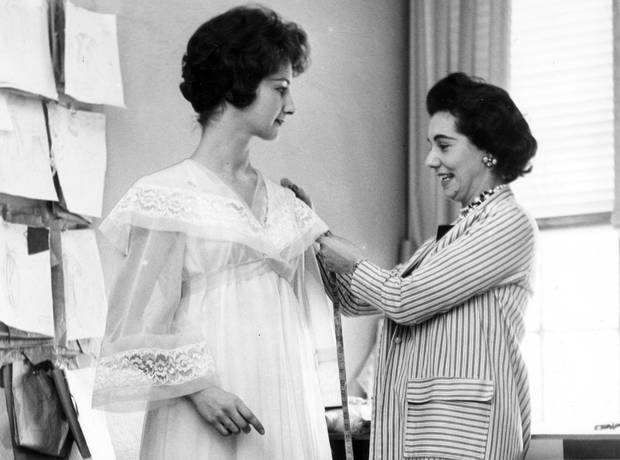 Claire Haddad, who taught herself to sew at the age of 10, achieved global success with her elegant, feminine designs. Here, she measures model Kathryn Fell for a peignoir set in 1959.