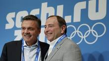 International Ice Hockey Federation president Rene Fasel poses for a picture with National Hockey League commissioner Gary Bettman after a joint news conference at the 2014 Sochi Winter Olympics, February 18, 2014. (JIM YOUNG/REUTERS)