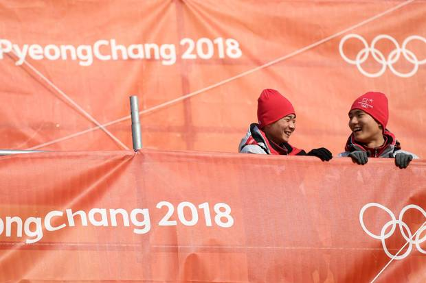 Volunteers attend the men's slalom event at the Yongpyong Alpine Centre on Feb. 22, 2018 in Pyeongchang.