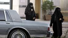 Saudi women walk past a parked car in Riyadh June 9, 2005. (Zainal Abd Halim/Reuters/Zainal Abd Halim/Reuters)