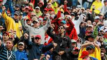 Fans react to the decision to start under the safety car during the Canadian Formula One Grand Prix at the Circuit Gilles Villeneuve on June 12, 2011 in Montreal. (Paul Gilham/Paul Gilham/Getty Images)