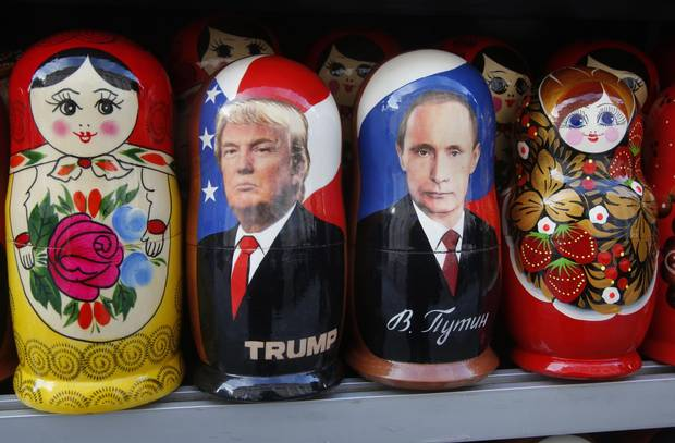 Traditional Russian matryoshka dolls depicting Russian President Vladimir Putin and Mr. Trump are displayed for sale at a street souvenir shop in St. Petersburg on Friday.