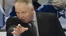 Toronto Maple Leafs head coach Randy Carlyle talks with players during first period NHL hockey game action against the Montreal Canadiens in Montreal, Saturday, March 3, 2012. THE CANADIAN PRESS/Graham Hughes (Graham Hughes)