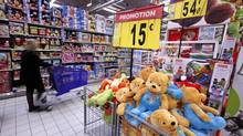 A customer shops for toys at Carrefour Planet supermarket in Nice, France in this file photo. The French company is the world's second-largest retailer. (ERIC GAILLARD/REUTERS)