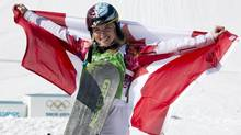 Canada's Dominique Maltais celebrates her silver medal win following the Ladies Snowboard Cross final at the Sochi Winter Olympics in Krasnaya Polyana, Russia, Sunday, Feb. 16, 2014. (Jonathan Hayward/THE CANADIAN PRESS)