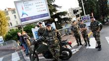 French soldiers stand ready in Cannes, southeastern France, three days ahead of the G20 summit held in this city. (Valery Hache/AFP/Getty Images/Valery Hache/AFP/Getty Images)