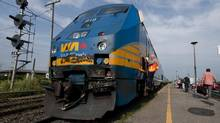 A Via Rail train takes on passengers at Dorval Station in Montreal. (Peter Mccabe/The Canadian Press)