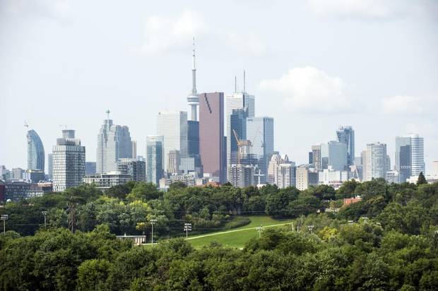The west looking view from Riverdale Park East offers the Toronto skyline beyond the trees of the Don Valley and Riverdale Park West on Aug. 7, 2014.
