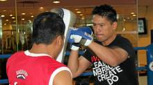 Bruce Poon throws punches at a boxing camp in Bangkok, Thailand. (Chad Krolouski/Chad Krolouski)