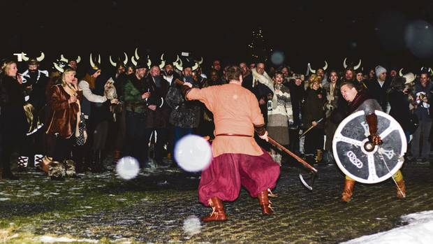 Guests attending the wedding of Canadian fashion director Mosha Lundström Halbert and British-born Aidan Butler at a pre-party viking-themed event in Iceland.