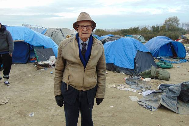January, 2016: Mr. Smith visits the 'Jungle' refugee camp in Calais, France. Mr. Smith is a vocal critic of the war in Syria.