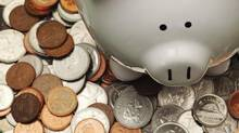 Piggy bank with Canadian coins. (Jason Verschoor/iStockphoto)