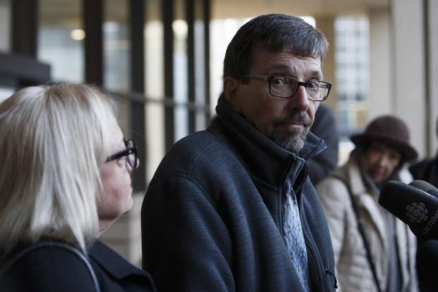 Bret McCann, flanked by his wife, Mary-Ann McCann, left, speaks to the media after giving a victim-impact statement during Travis Vader's sentencing hearing.
