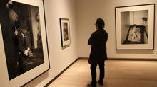A visitor looks at Stan Douglas photographs in the new gallery. (Fernando Morales/The Globe and Mail)