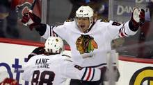 Chicago Blackhawks' Marian Hossa, right, from Slovakia, celebrates his tying goal with teammate Patrick Kane during overtime NHL action in Calgary, Alta., Saturday, Feb. 2, 2013. The Chicago Blackhawks beat the Calgary Flames 3-2 in a shootout. (Jeff McIntosh/THE CANADIAN PRESS)