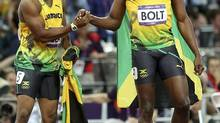 Yohan Blake and Usain Bolt, both of Jamaica, after the men's 100-metre track competition at the 2012 Summer Olympic Games in London on Sunday. (JED JACOBSOHN/NYT)