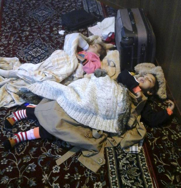 Karima, 5, and Ayat, 1, children of Iwan and Zamzam Dalaa, sleep in the airport mosque after not being allowed to board a commercial flight that would take them to Canada. The family was one of several Syrian refugees left stranded in Beirut after being denied boarding.