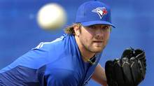Toronto Blue Jays pitcher Kyle Drabek throws in the bullpen during practice at their MLB American League spring training facility in Dunedin, Florida Feb. 25, 2012. (Mike Cassese/Reuters/Mike Cassese/Reuters)