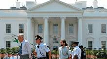 Police arrest protestors who were demonstrating infront of the White House August 24, 2011 in Washington, DC. (MANDEL NGAN/AFP/Getty Images/MANDEL NGAN/AFP/Getty Images)