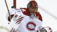 Montreal Canadiens goalie Jaroslav Halak makes a save on the Washington Capitals during the third of action in Game 7 of their NHL Eastern Conference quarter-final hockey series in Washington, April 28, 2010. (JIM YOUNG/REUTERS)