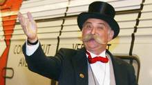 A man dressed as Mr. Monopoly (H. RUMPH, JR)