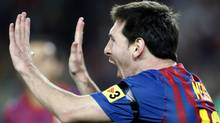 Barcelona's player Lionel Messi celebrates his goal against Racing de Santander during their Spanish first division soccer match at Nou Camp stadium in Barcelona October 15, 2011 REUTERS/Gustau Nacarino (Gustau Nacarino/Reuters)