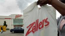 .A shopper removes her bags from a shopping cart in the parking lot of a Mississauga Zellers store. (J.P. Moczulski/J.P. Moczulski/The Globe and Mail)