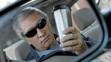 Toronto, 07/10/11 - Peter Cheney poses for a photo with a travel mug in his car in Toronto, Ontario, Canada, for a story on finding the perfect travel mug. (Deborah Baic/Deborah Baic/The Globe and Mail)