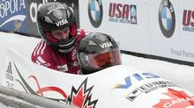 Lyndon Rush, front, and Jesse Lumsden of Canada celebrate their second place finish in the men's bobsleigh at the FIBT World Bobsleigh Championships in Lake Placid, N.Y., on Sunday. (ADAM FENSTER)