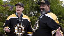 Hockey fans Cecil Wright, right, and his friend Marc Cayouette display their support for the Boston Bruins at work in Halifax on Friday, June 3, 2011. The Bruins have a large fan base in the Maritimes, bolstered by family ties and historic north-south loyalties.THE CANADIAN PRESS/Andrew Vaughan (Andrew Vaughan/CP)
