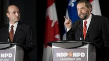 NDP leadership candidate Thomas Mulcair, right, makes a point as fellow candidate Nathan Cullen looks on during an NDP leadership debate in Montreal on March 4, 2012. (Graham Hughes/The Canadian Press/Graham Hughes/The Canadian Press)