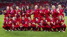 Canada's women's soccer team poses for a team photo after being presented with their bronze medal at the 2012 Summer Olympics in Coventry, England, Thursday August 9/2012. (Kevin Van Paassen/The Globe and Mail)