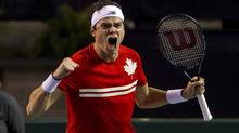 Canada's Milos Raonic celebrates his win over Italy's Andreas Seppi in their Davis Cup quarter-final tennis match in Vancouver on April 7, 2013. With Raonic's victory, Canada advances to the Davis Cup semi-finals for the first time in modern history. (BEN NELMS/REUTERS)